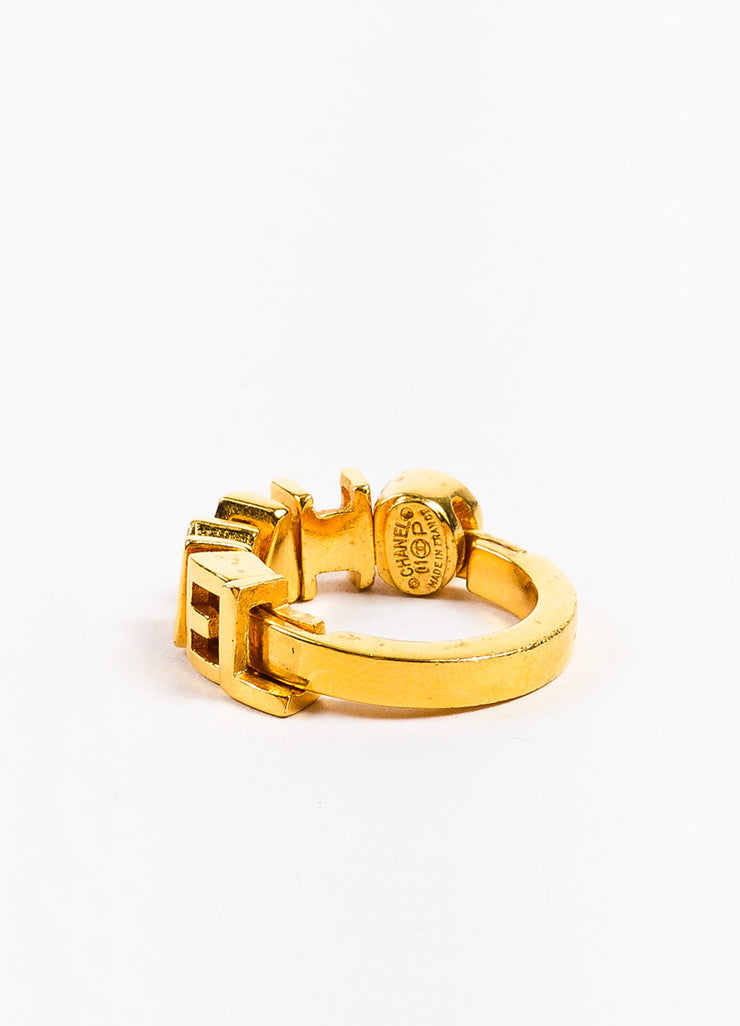 Chanel Gold Toned Charm Letter Embellished Band Ring Backview