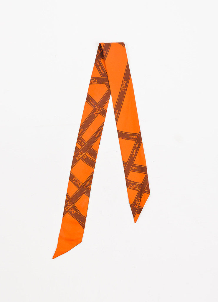 "Hermes Orange Silk Printed ""Bolduc"" Twilly Scarf frontview"