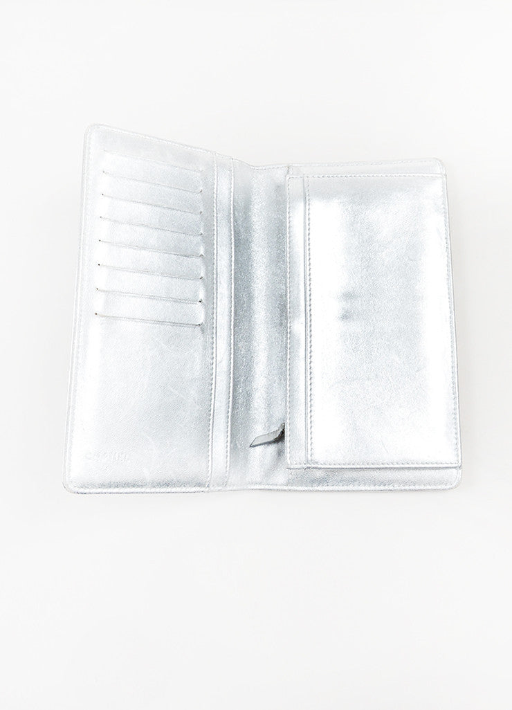 "Chanel Metallic Silver Leather Embossed ""Precious Symbols"" Vertical Coat Wallet Interior"