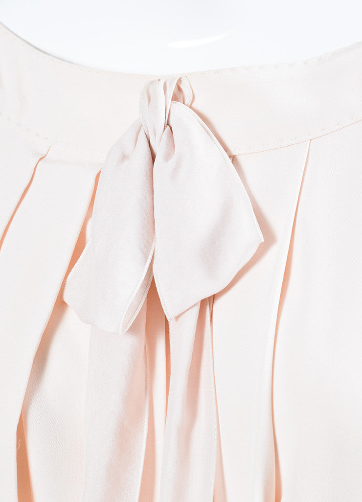 Pale Pink Louis Vuitton Pleated Cut Out Bow Short Sleeve Dress Detail