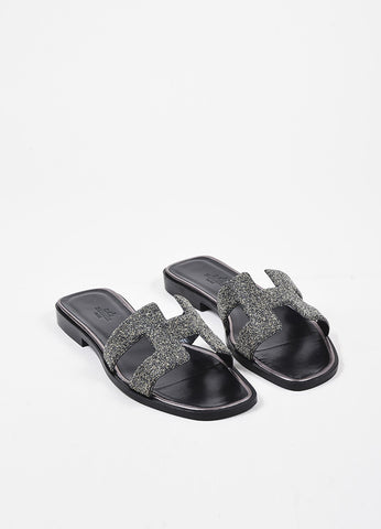 "Hermes Black and Metallic Silver Leather 'H' Flat ""Oran"" Sandals Frontview"