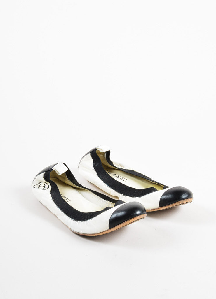 "Chanel Cream and Black Cap Toe ""CC"" Logo ""Spirit"" Flats Frontview"