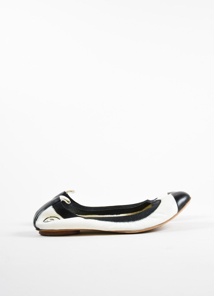 "Chanel Cream and Black Cap Toe ""CC"" Logo ""Spirit"" Flats Sideview"