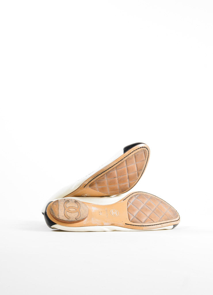"Chanel Cream and Black Cap Toe ""CC"" Logo ""Spirit"" Flats Outsoles"