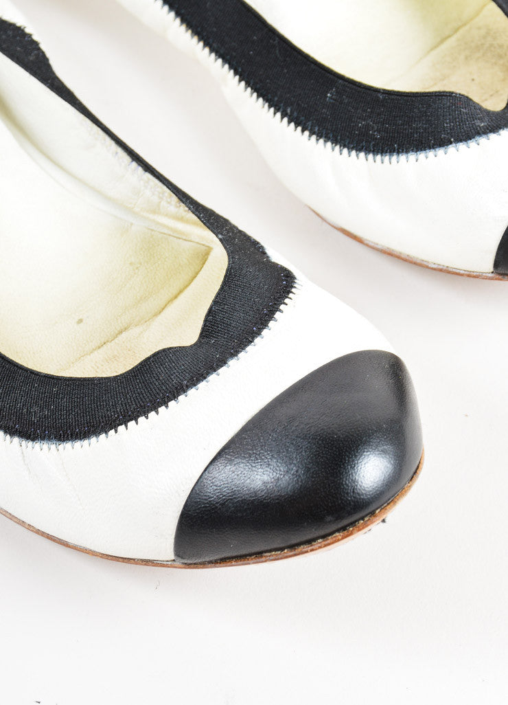 "Chanel Cream and Black Cap Toe ""CC"" Logo ""Spirit"" Flats Detail"