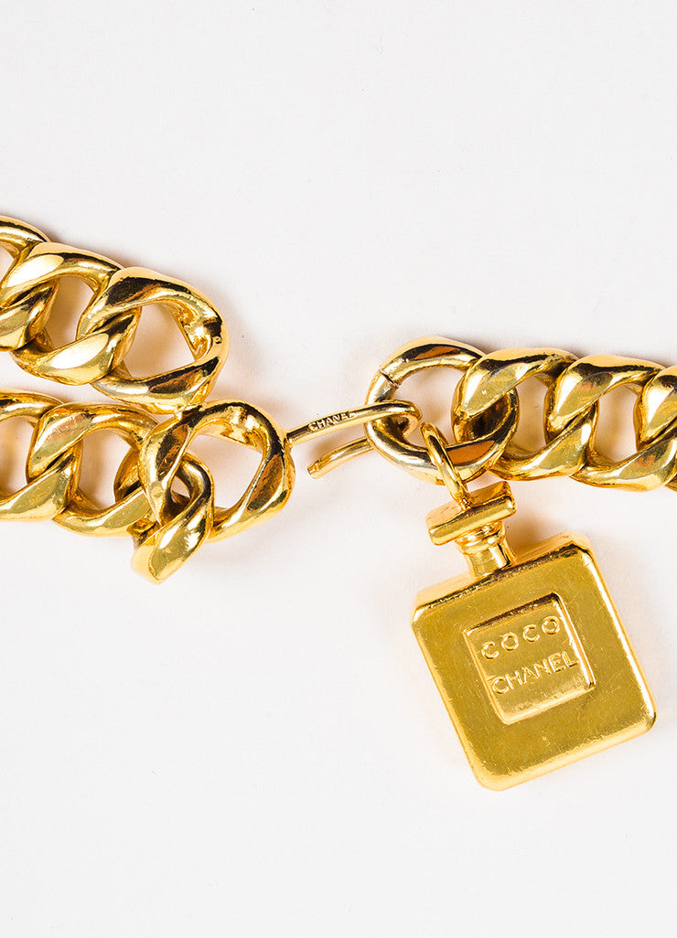 Chanel Gold Toned Perfume Charm Tassel Curb Chain Belt Closure
