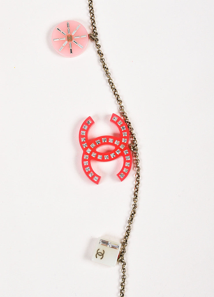 Chanel Silver Toned and Pink Crystal Accent Geometric 'CC' Charm Strand Necklace Detail