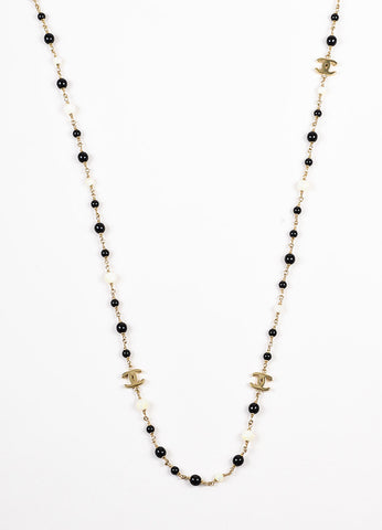 Chanel Gold Toned, Black, and Iridescent White Beaded 'CC' Logo Necklace Detail