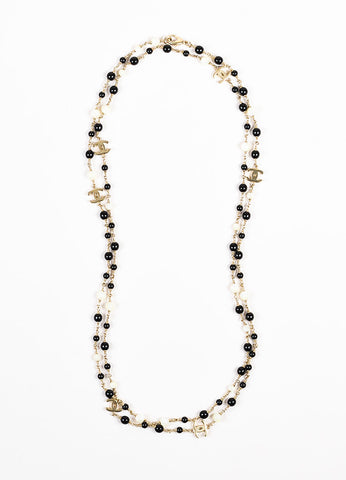 Chanel Gold Toned, Black, and Iridescent White Beaded 'CC' Logo Necklace Frontview