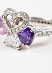 Platinum, Diamond. Pink Sapphire, and Amethyst Four Heart Ring Detail