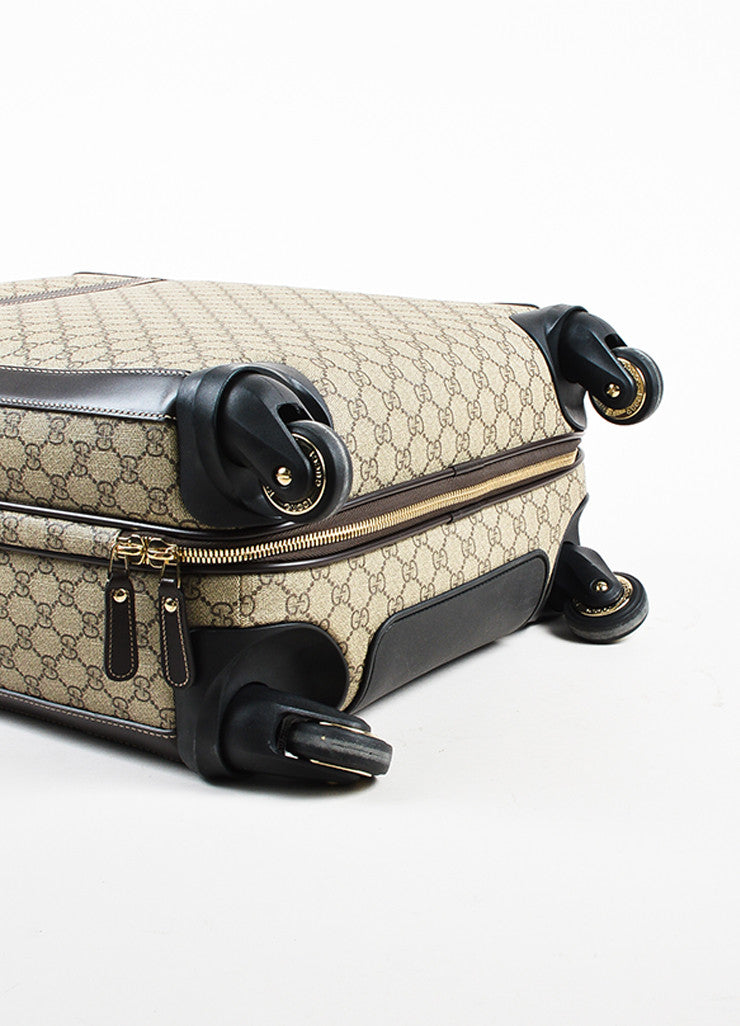 "Gucci Brown and Tan Coated Canvas ""GG Supreme Four Wheel Carry On"" Suitcase Bottom View"