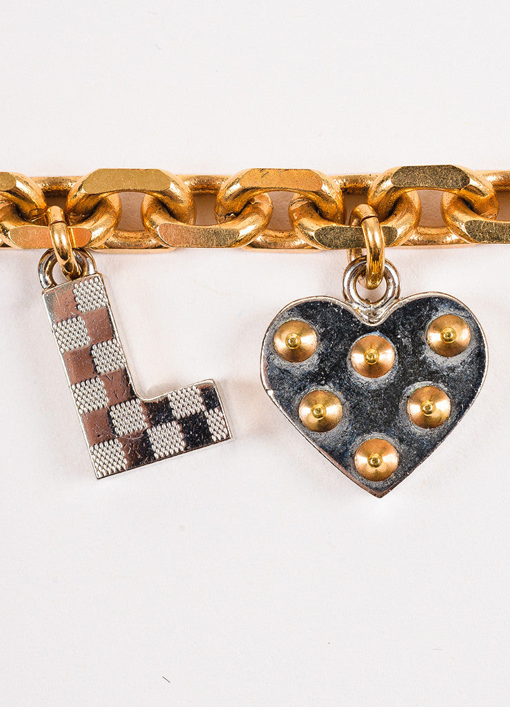 Louis Vuitton Gold and Silver Toned Pink Crystal Studded 'LOVE' Charm Link Bracelet Detail