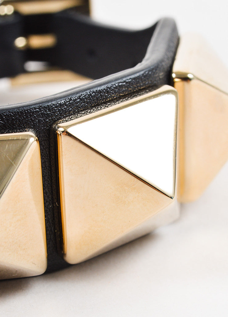 "Valentino Black and Gold Toned Leather ""Va Va Voom Rockstud"" Buckle Bracelet Detail"