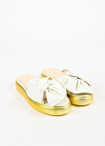 "Charlotte Olympia White and Gold Leather Bow ""Poolside"" Flatforms Frontview"