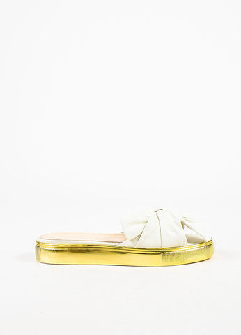 "Charlotte Olympia White and Gold Leather Bow ""Poolside"" Flatforms Sideview"