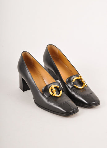 Black Leather Stacked Heels with a Gold Toned Toggle