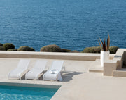 Latona Sun Lounger by pool