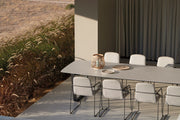 Loop Dining Chair around table on terrace