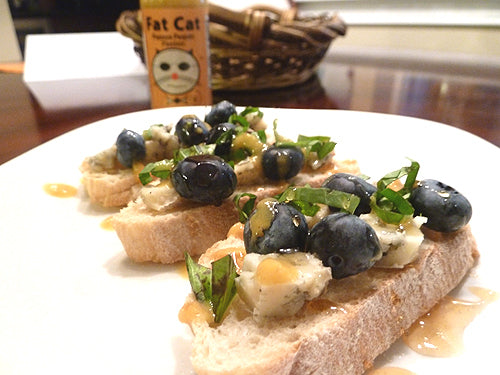 Blueberry, Blue Cheese & Basil Crostini with Honey & Papaya Pequin Passion Hot Sauce