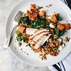 Healthy Grilled chicken breast, chopped lemon and artichoke pesto, herbed quinoa