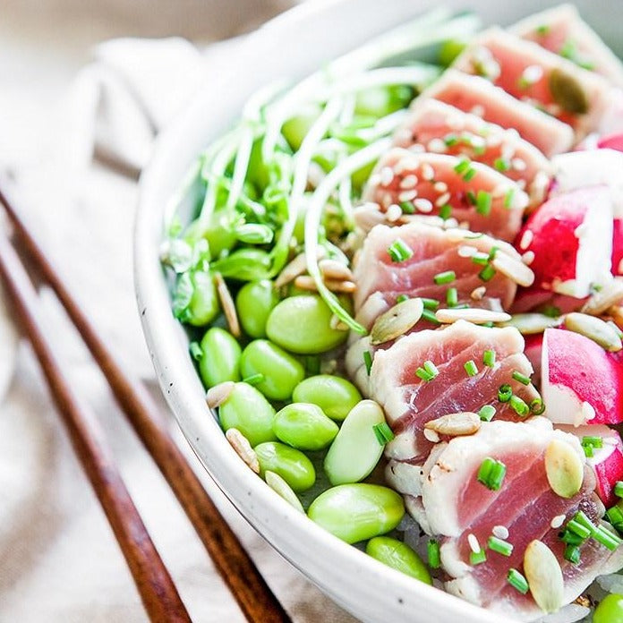 Quinoa, chickpea, edamame, cucumber and tuna tataki bowl