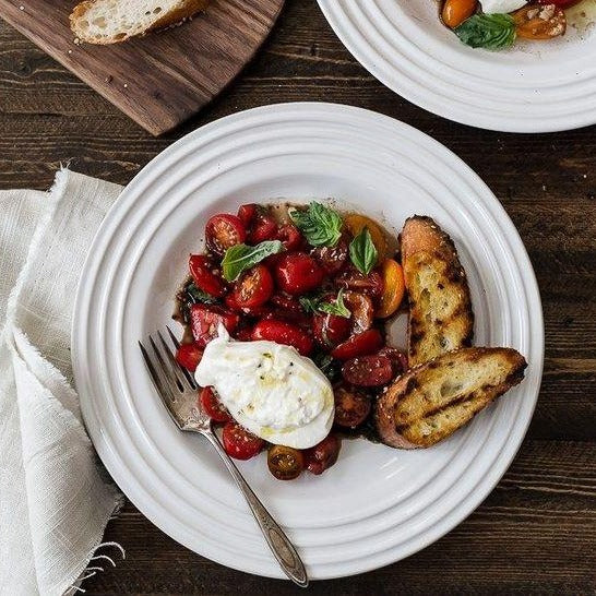 Classic burrata with cherry tomato confit, artichoke and olives (1 portion)