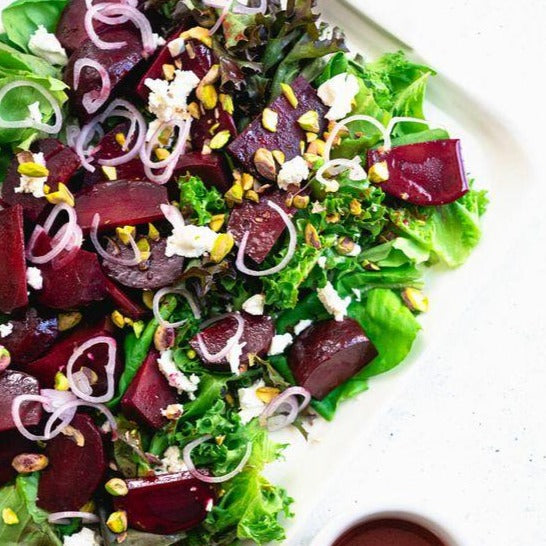 Beet salad, goat cheese, spinach, mix lettuce, candied walnuts