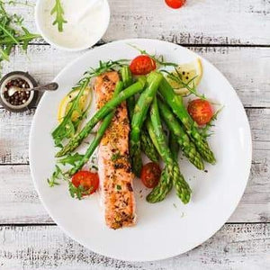 Grilled Salmon, asparagus, confit tomatoes and cucumber sauce