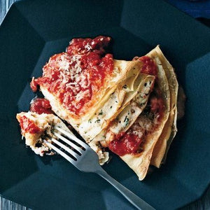 Ricotta and spring onions crespelle with tomato sauce