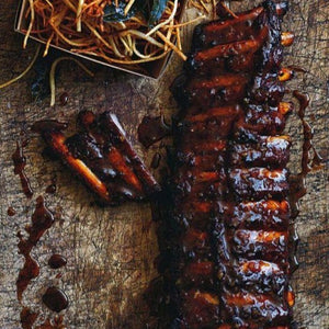Barbecue beef ribs with sweet onion hasselback potatoes