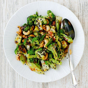 Sweet and sour broccoli and cashew stir fry on vermicelli