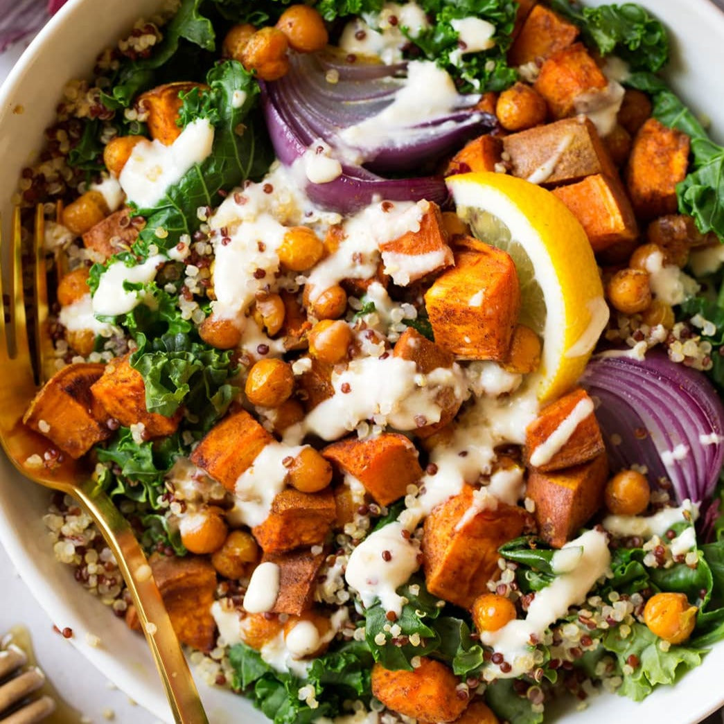 Quinoa, sweet potato and chickpea buddha bowl with ginger tahini sauce