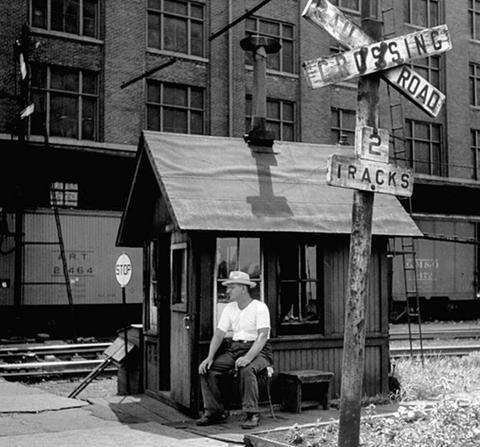 historical photo of manned cabin at railroad crossing