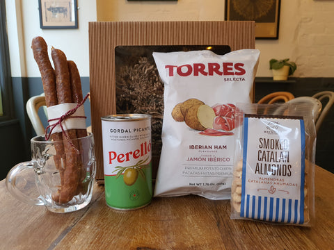 foh snack box with olives, almonds, beersticks and iberico ham crisps