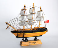 Small Black and Gold Ship