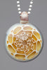 Yunk: Clear Carved Pendant 10