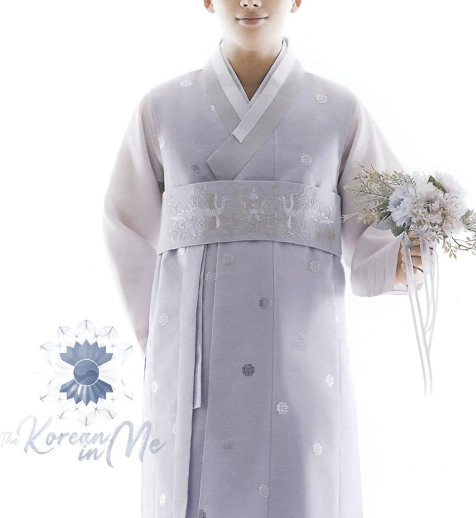 Man wearing custom grooms hanbok pastel lilac top while holding flowers