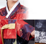 Woman wearing custom mother of the bride hanbok with red top and navy skirt closeup