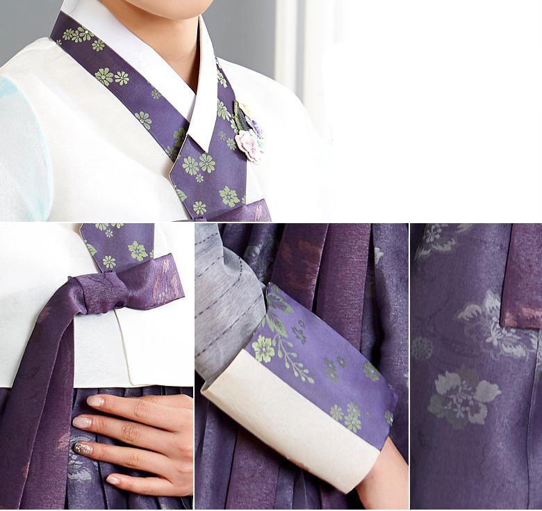 Woman wearing custom mother of the bride hanbok with white top and purple skirt closeup