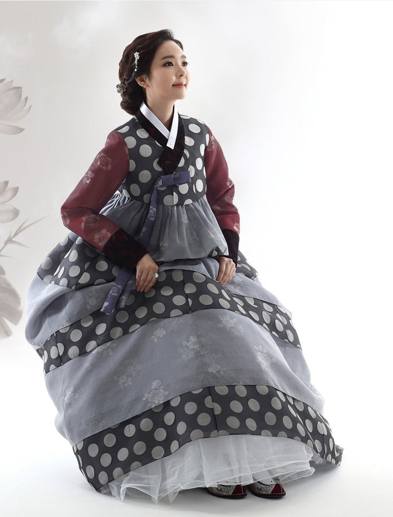 Woman wearing a Custom Women's Bridal Hanbok with Polka Dots Sitting Down