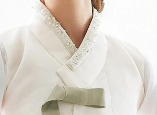 Closeup on top of Woman wearing Custom Women's Bridal Hanbok in Floral Sheer Pearl style