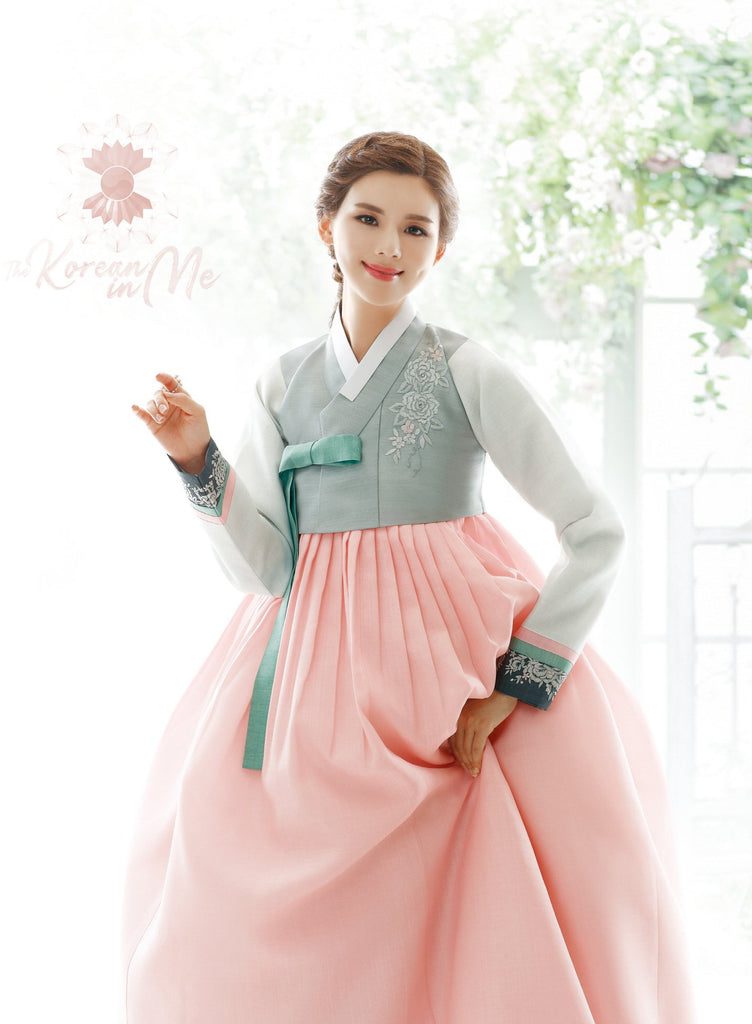 Woman smiling and wearing Custom Women's Bridal Hanbok in Pale Floral style