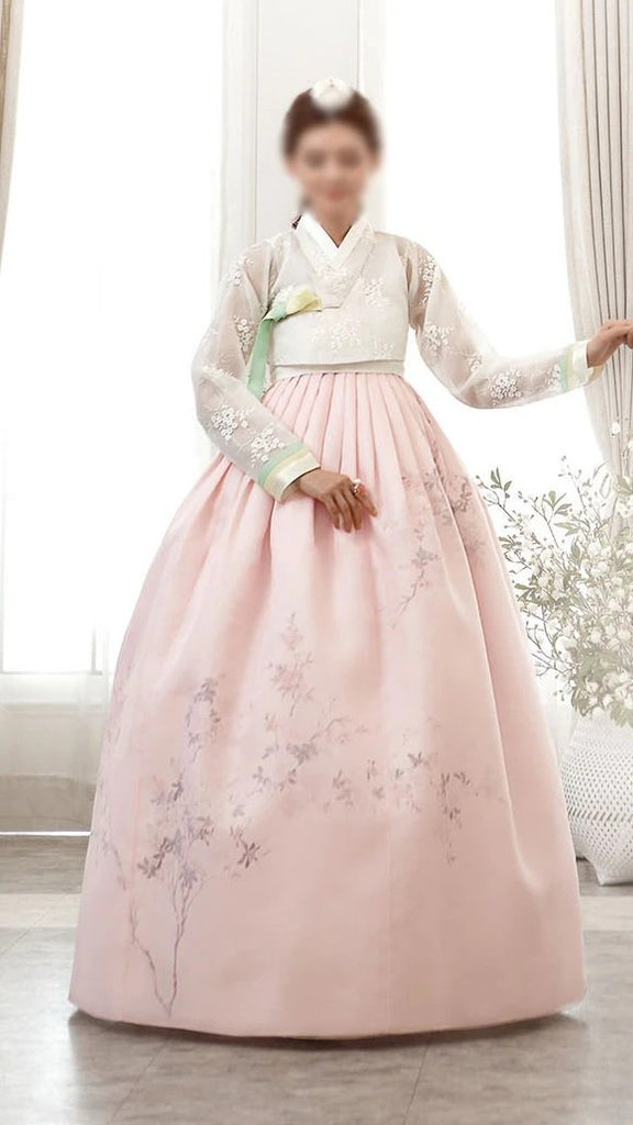 Woman posing in Custom Women's Bridal Hanbok in Peach Tulle style