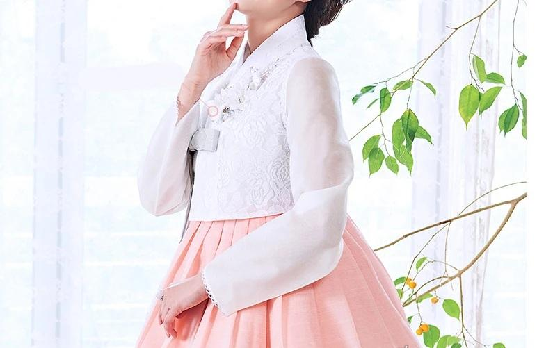 Closeup of woman wearing Custom Women's Bridal Hanbok in Peach