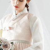 Closeup of Woman wearing a custom womens bridal hanbok in lace and pastel pink style