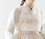 Closeup of top of custom womens bridal hanbok in lace and pastel pink style