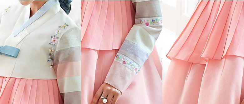 Closeup of woman wearing a custom womens bridal hanbok in pink
