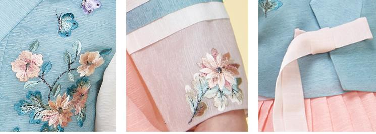 Closeup of young girl wearing a girls korean hanbok with blue floral top and pink skirt