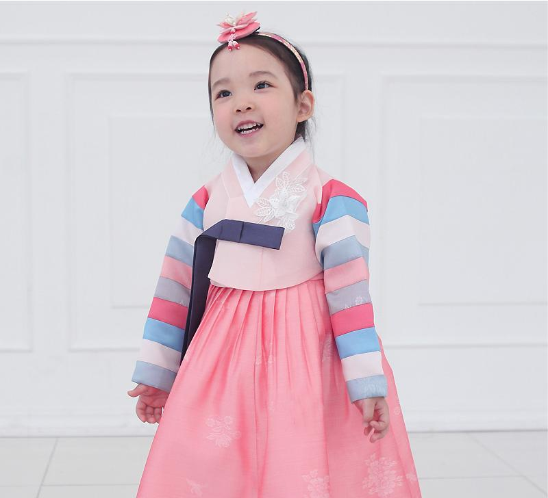 Young girl wearing a girls korean hanbok with pink top and skirt