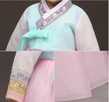 Closeup of young girl wearing a girls korean hanbok with lavender top and pink skirt